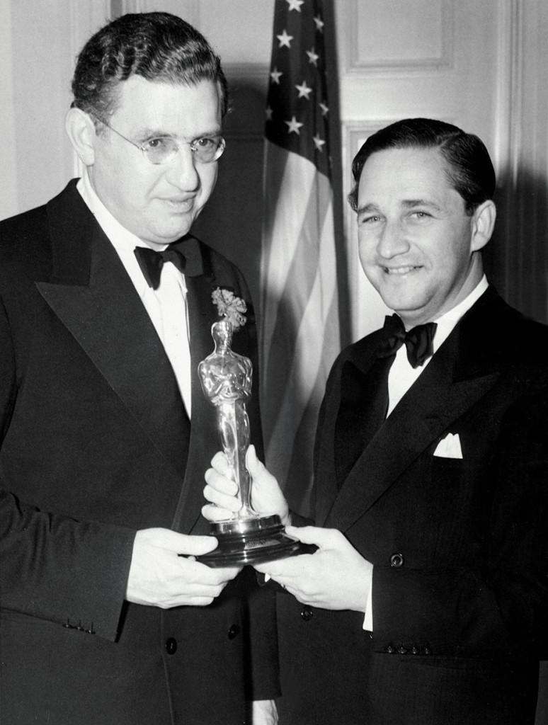 DAVID O. SELZNICK (Best Picture, GONE WITH THE WIND) picks up his Oscar from MERVYN LE ROY, 3/2/40