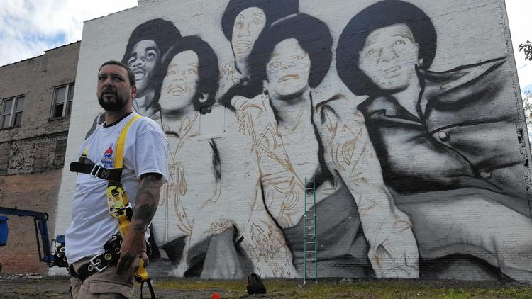 Mural in downtown gary progressing for Jackson 5 mural